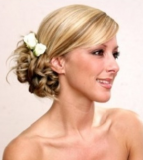 Elegant bride or bridesmaid with flowers